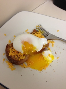 Skillet egg with toast and shredded cheddar cheese