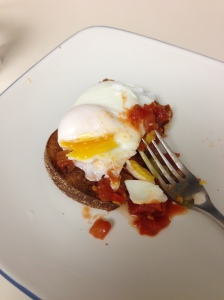 Egg made in the pan with toast and mild salsa